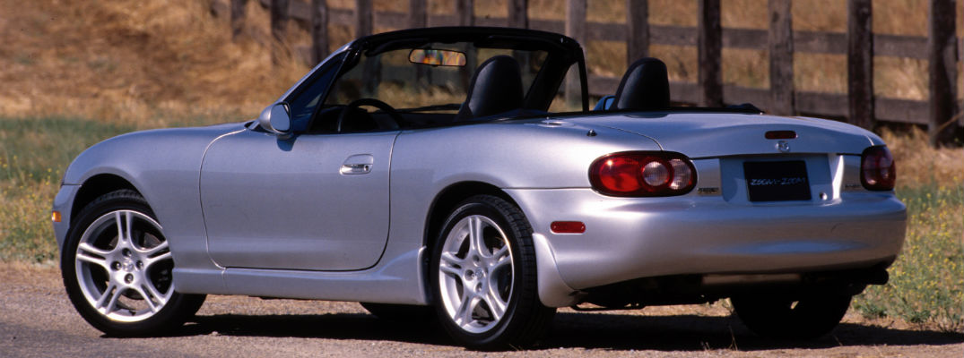 A left profile photo of a 2004 Mazda MX-5 Miata.