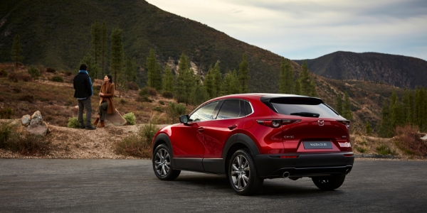 Red 2019 Mazda CX-30 Rear Exterior on a Trail