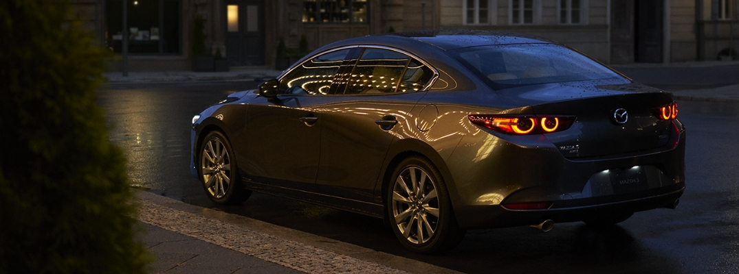 Gray 2019 Mazda3 Rear Exterior on City Street at Night