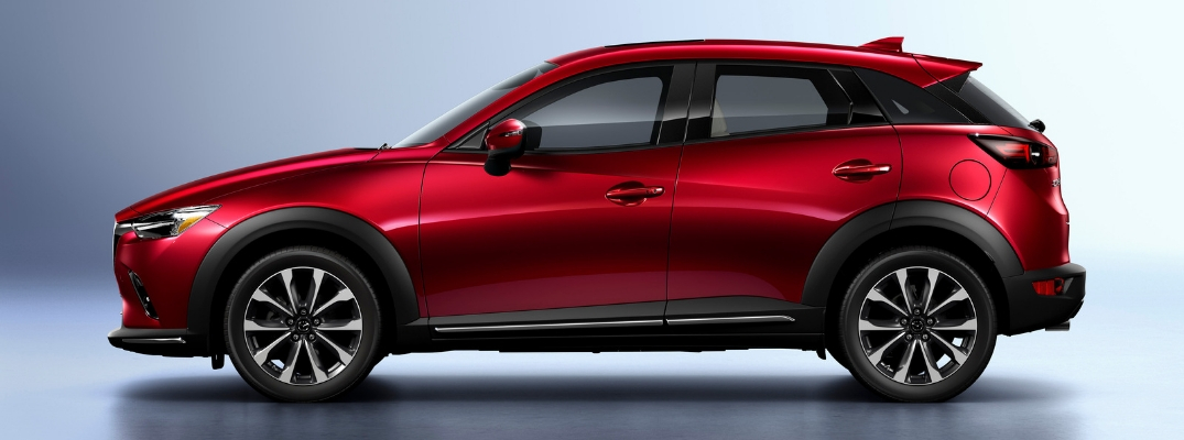 Red 2019 Mazda CX-3 Side Exterior on Gray Background