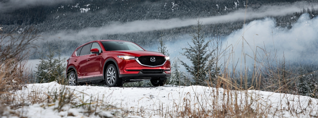 Red 2019 Mazda CX-5 on a Snowy Hill