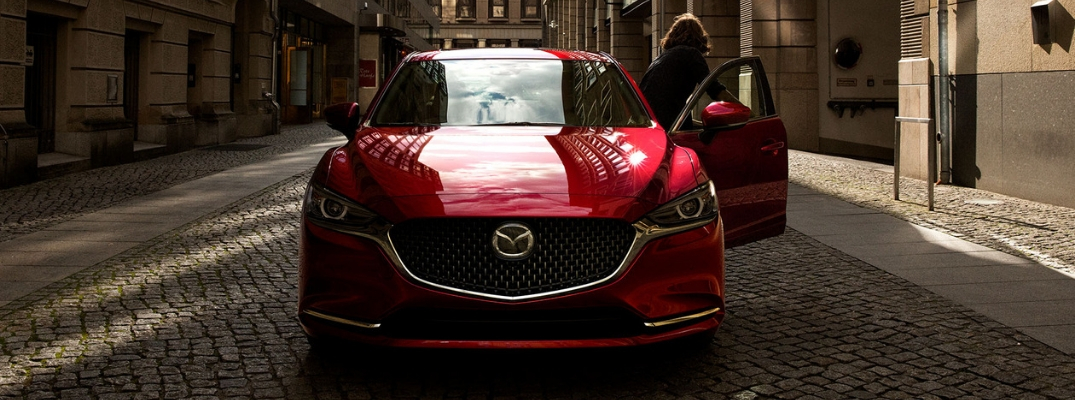 Woman Getting Out of Red 2019 Mazda6 on Cobblestone Street