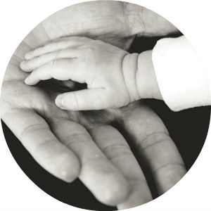 Close Up of a Child's Hand in a Man's Hand