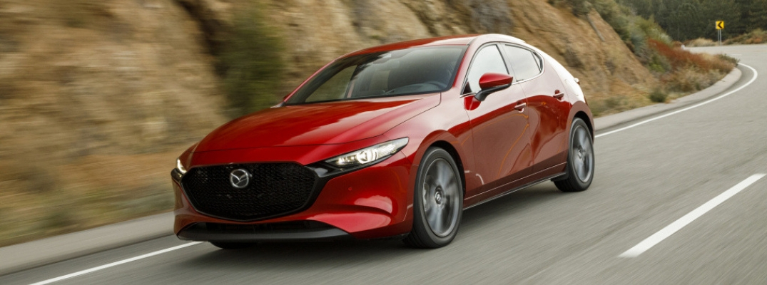 Red 2019 Mazda3 Hatchback on a Curvy Mountain Road