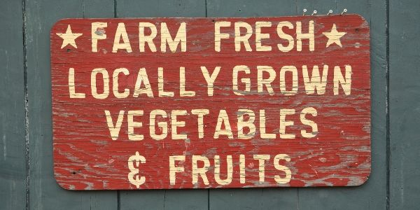 Red Wood Sign with White Farm Fresh Locally Grown Vegetables and Fruits Text