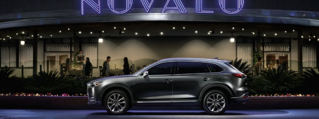 Gray 2019 Mazda CX-9 Parked in Front of a Restaurant at Night