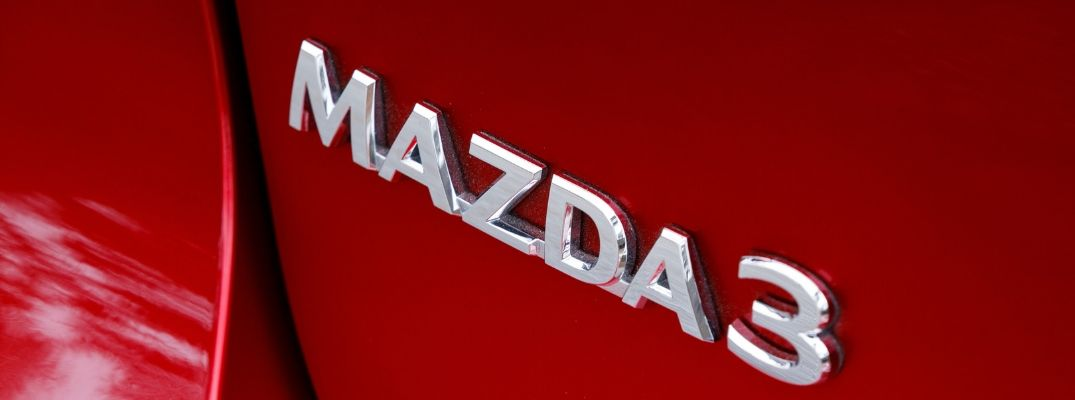 Close Up of Mazda3 Badge on a Red 2019 Mazda3 Hatchback