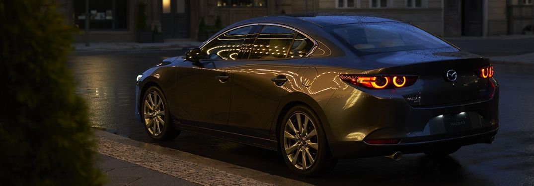 2019 Mazda3 parked along street at night