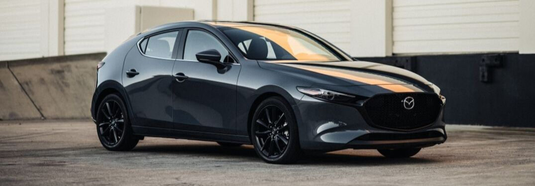 2020 Mazda3 hatchback parked by loading docks