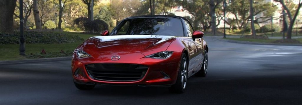 2019 Mazda MX-5 Miata on road through wooded area