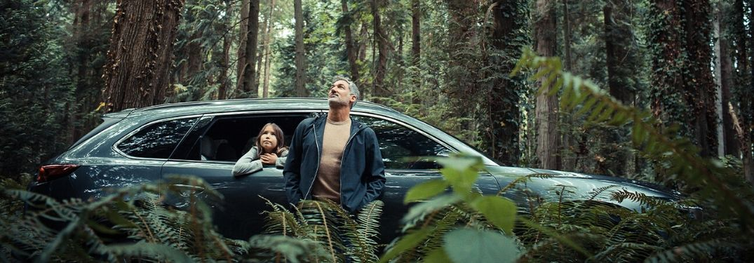 family with 2020 Mazda CX-9 in forest