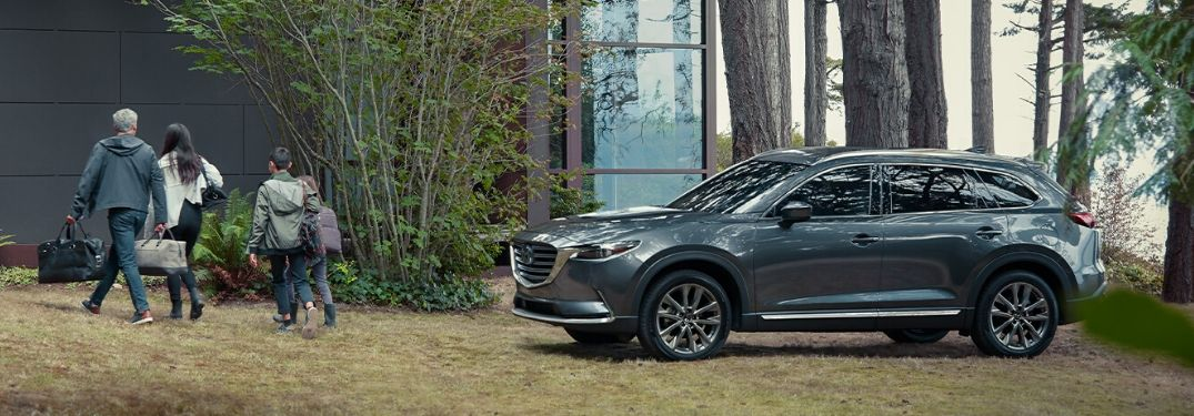 2020 Mazda CX-9 parked in grassy, forested area