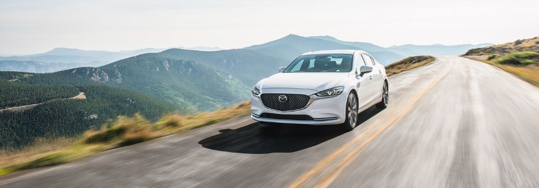 2020 Mazda6 on road overlooking scenic forest