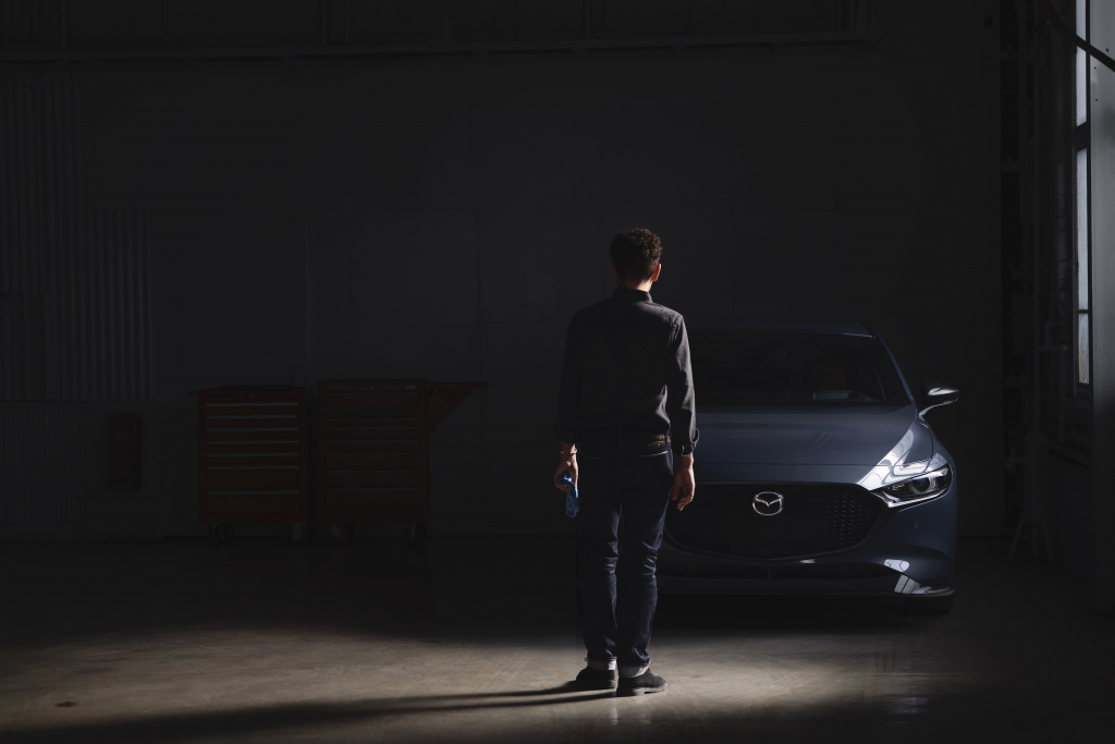2021 Mazda3 2.5 Turbo in Shadows with Man Standing in Front