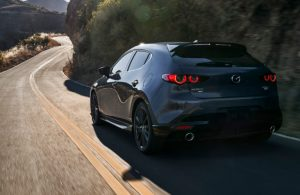 2021 Mazda3 2.5 Turbo Hatchback on mountainside road viewed from rear