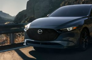 2021 Mazda3 2.5 Turbo Hatchback on mountainside road viewed from front