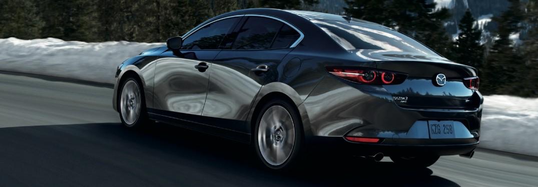 2021 Mazda3 Sedan on snow-lined road