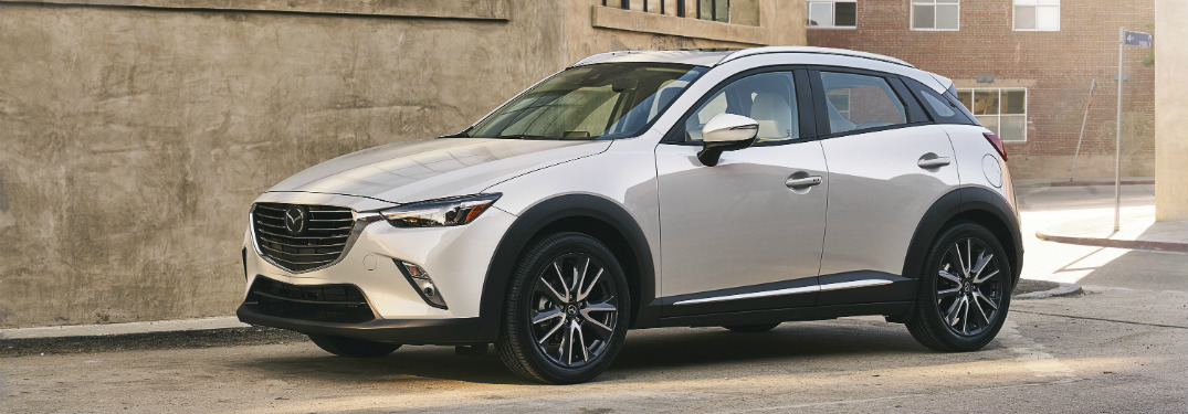 white 2018 mazda cx-3 parked in front of cement wall