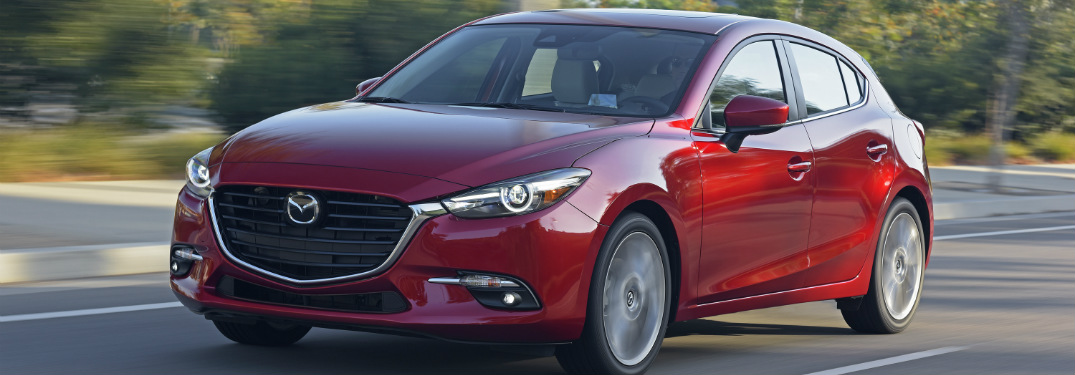 ... Red 2018 Mazda Mazda3 Driving On Empty Road