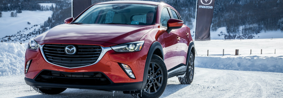 red 2018 mazda cx-3 on snowy road