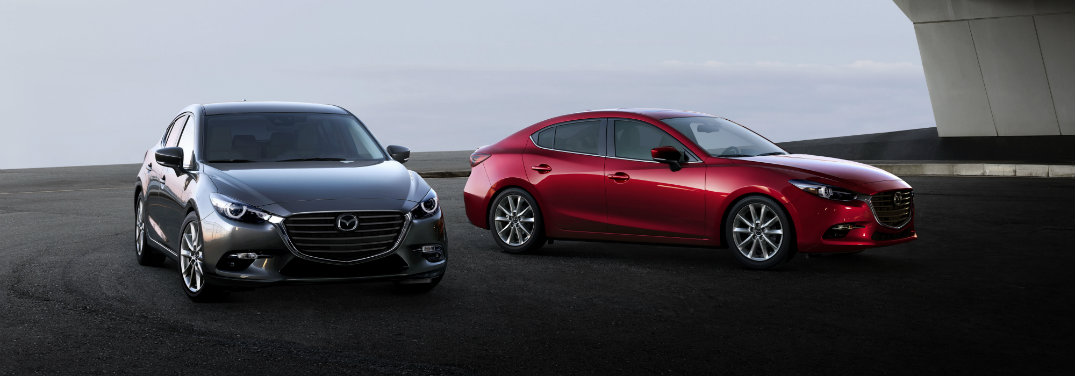 gray and red mazda3 hatchback cars
