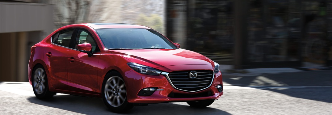 A red, parked 2018 Mazda3