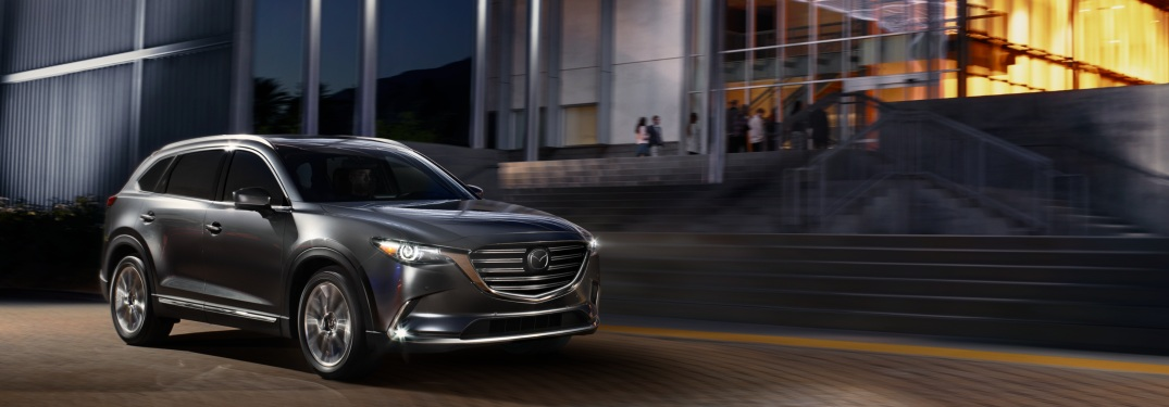 2019 Mazda CX-9 parked in front of a building at night