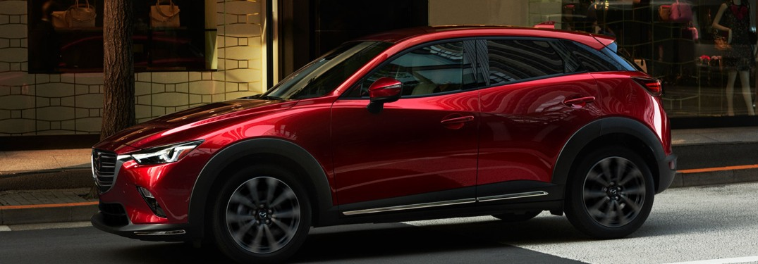 2019 Mazda CX-3 driving down a city street