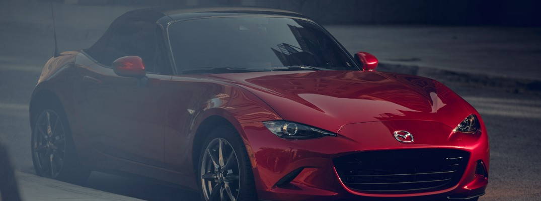 2019 Mazda MX-5 Miata exterior shot red paint driving to the right