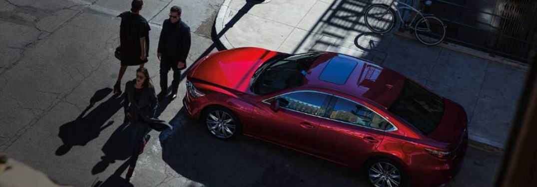 2020 Mazda6 parked and waiting for crossing passengers