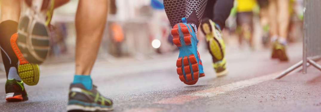 Close-up on the legs of a group of runners