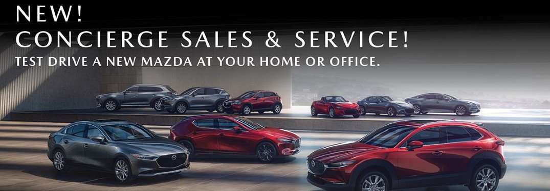 """A showcase of Mazda vehicles ina darkened room with an overlayed text that says """"New! Concierge Sales and Service! Test drive a new Mazda at your home or office."""""""
