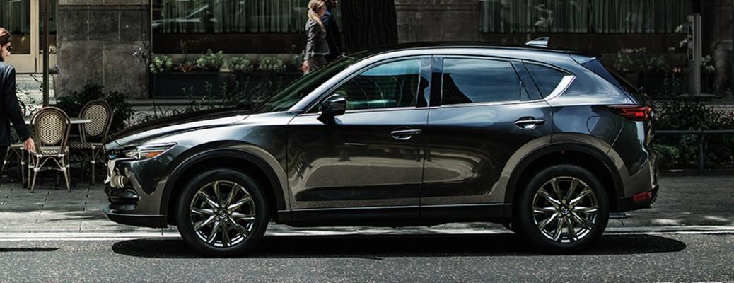 A side image of a 2020 Mazda CX-5 parked along a city street.
