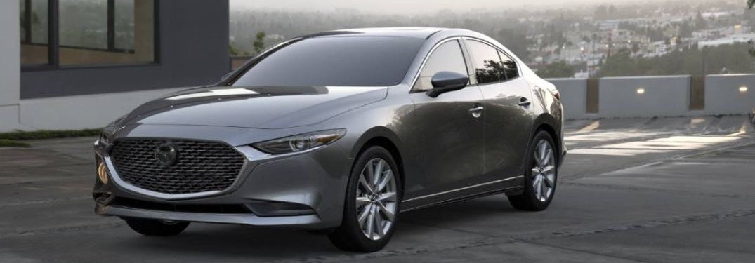 The front and side view of a gray 2021 Mazda3 Sedan.