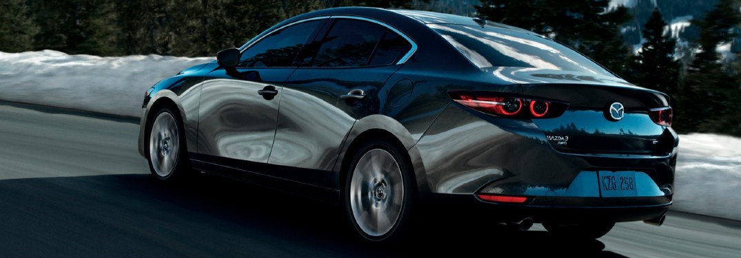 The side and rear view of a gray 2021 Mazda3 Sedan.