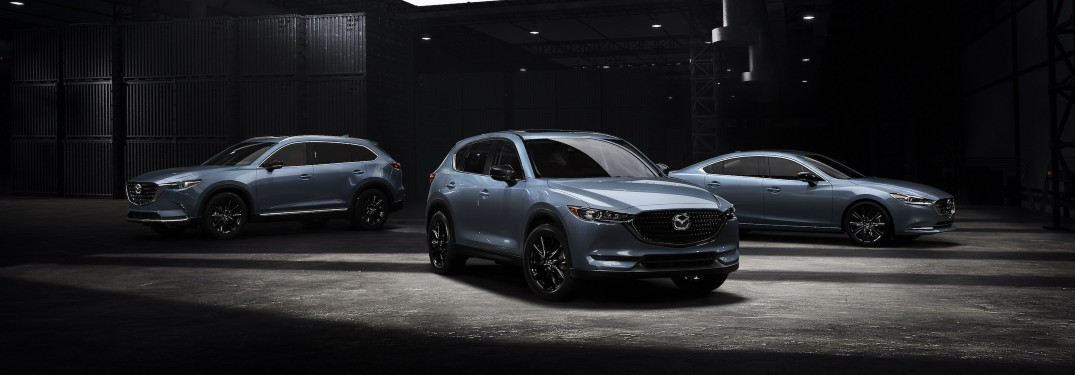Three gray 2021 Mazda Carbon Edition models parked in an enclosed space.
