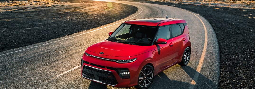 2020 red kia soul on curved road