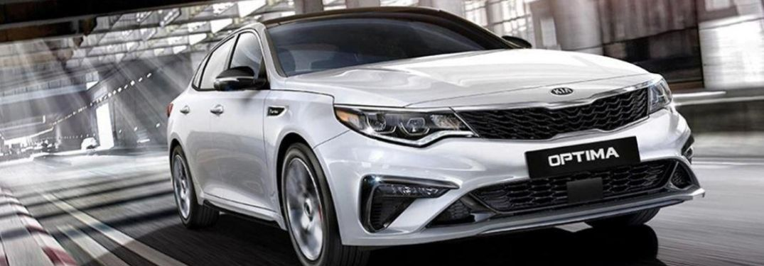 2020 Kia Optima front view while on the road