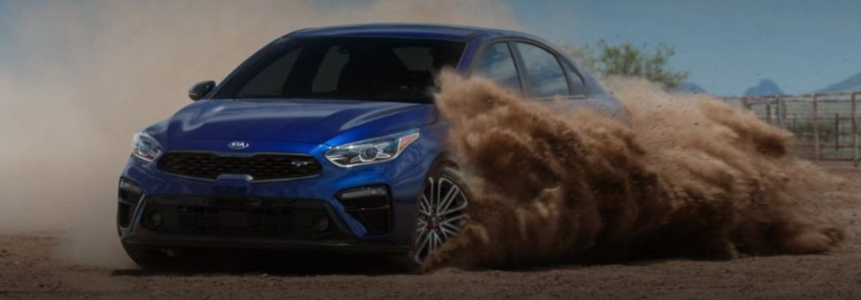 2021 Kia Forte driving on sand
