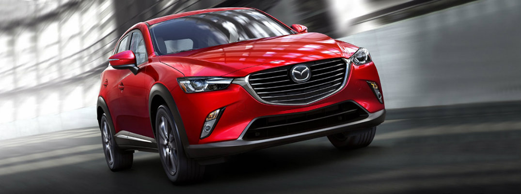 2018 mazda cx-3 in red driving in tight parking garage location