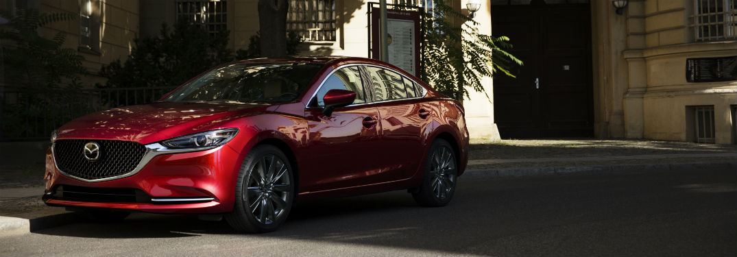 2018 mazda6 shown in new red color outside big mansion near wilson nc