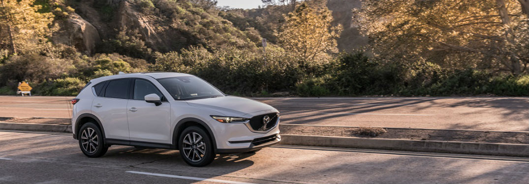 2017 and 2018 mazda cx-5 in white parked driving on desert road