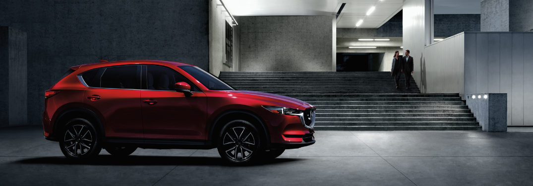 2018 cx-5 profile in red parked in front of dark building