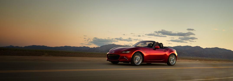 2018 Mazda MX-5 Miata soft top driving through desert