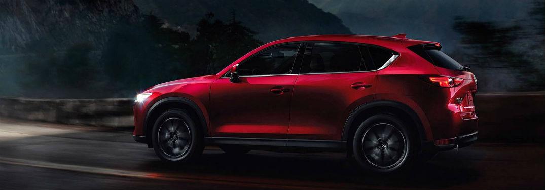 2018 mazda cx-5 in red grand touring on dark desert road driving