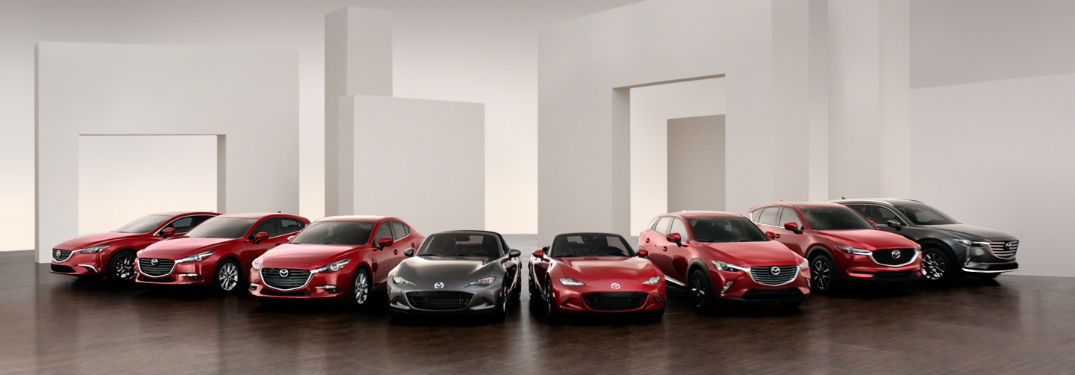 Mazda cars lined up in studio somewhere