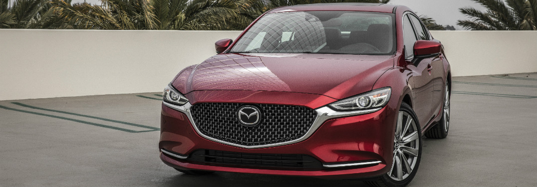 front view of red 2018 mazda6 on concrete driveway