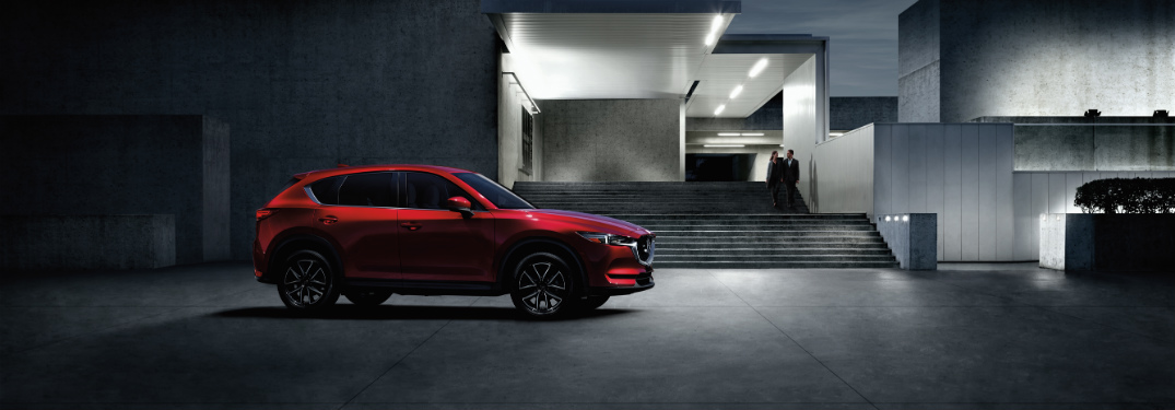 red 2018 mazda cx-5 in front of concrete modern home
