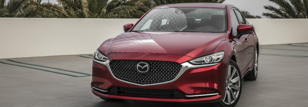 front view of red 2018 mazda6 in parking lot