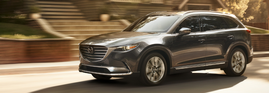 front and side view of blue 2019 mazda cx-9